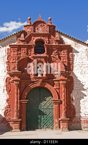 Ornate entrance to historic Santa Barbara church in village of Huancavelica in Andes Mountains of Peru, South America - Stock Photo