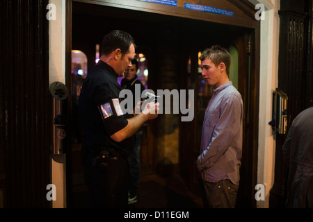 A bouncer in a nightclub stock photo royalty free image for Door bouncer age