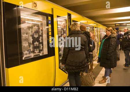 Berlin Germany EU Passengers waiting for doors to open on underground train - Stock Photo