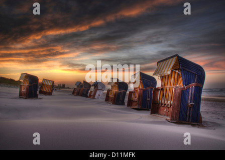 Germany, Roofed wicker beach chairs at Baltic Sea - Stock Photo