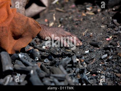 Hand Of A Woman In Coal, Adama, Ethiopia - Stock Photo