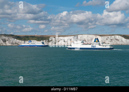 DFDS Seaways and P&O car ferries in front of the white cliffs of Dover - Stock Photo