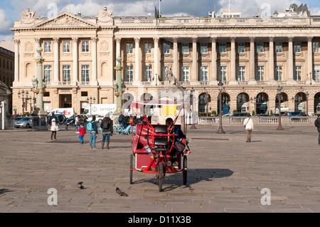 Rickshaw parked in Place de la Concorde in front of Hotel de Crillon Paris, France - Stock Photo