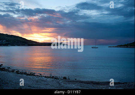 Sunset at Kassiopi Beach, Corfu, Ionian Islands, Greece - Stock Photo