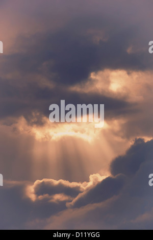 Sun Rays Bursting Through Storm Clouds; Spain - Stock Photo