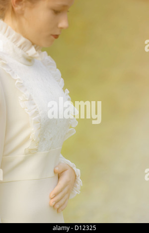 portrait of a beautiful young woman in a victorian dress - Stock Photo