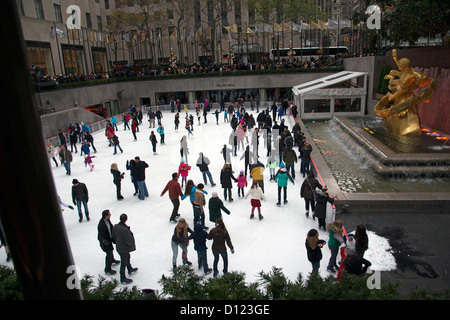 Skaters in action on the ice rink at Rockefeller Center New York USA - Stock Photo