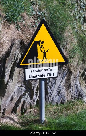 Sign Warning Of Dangerous Cliff Edge Sandy Cove West Cork; County Cork Ireland - Stock Photo