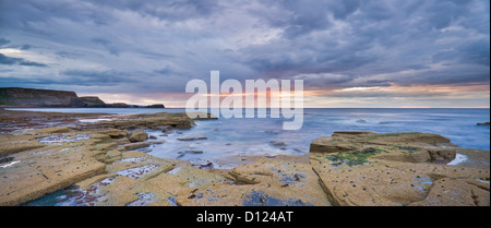 A Showery Evening At Low Tide In Saltwick Bay; Saltwick Bay North Yorkshire England - Stock Photo