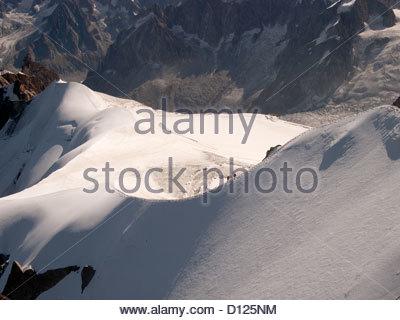 Snowfield at Aiguille du Midi towards Col du Plan - Stock Photo