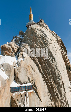Lookout Point On The Peak Of A Mountain Against A Blue Sky; Chamonix-Mont-Blanc Rhone-Alpes France - Stock Photo
