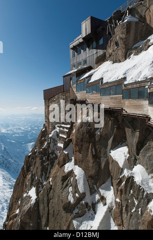 A Building With Windows Built Into The Mountain Of The French Alps; Chamonix-Mont-Blanc Rhone-Alpes France - Stock Photo