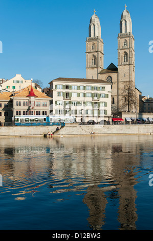 Buildings Along The Water's Edge Reflected In The Water; Zurich Switzerland - Stock Photo