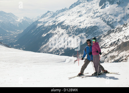 A Couple Skiing In The French Alps; Chaminox-Mont-Blanc Rhone-Alpes France - Stock Photo