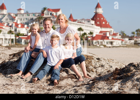 Happy Caucasian Family in Front of Hotel Del Coronado, U.S.A., on a Sunny Afternoon. - Stock Photo