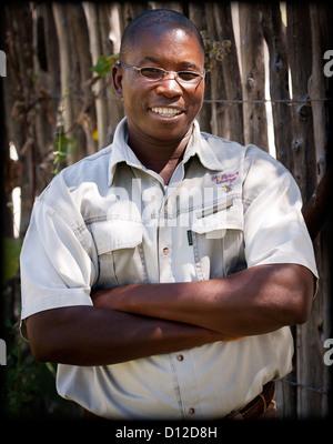 Game guide at Mushara Lodge, Etosha, Oshikoto Region, Namibia, Africa. - Stock Photo