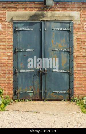 Old blue rusty padlocked metal door - Stock Photo & Old neglected locked blue door. India Stock Photo Royalty Free ... Pezcame.Com