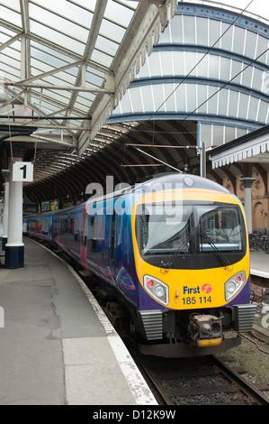 First Transpennine Express Class 185 passenger train waiting at a platform at York Railway Station, England. - Stock Photo