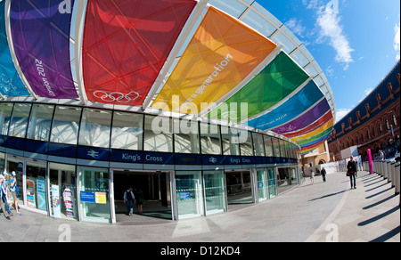 Colourful banners on display outside the entrance to the Kings Cross Railway Station during the London 2012 Olympics. - Stock Photo