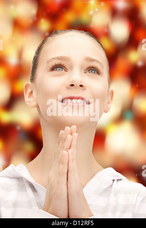 praying teenage girl - Stock Photo