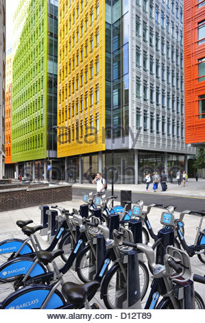 Colorful blocks of Central St. Giles and Barclays Cycle hire docking station, London UK - Stock Photo