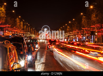 December illumination and traffic lights on the Avenue des Champs-Élysées in Paris,Europe. - Stock Photo
