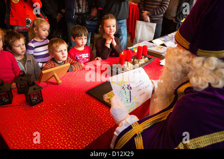 Saint Nicholas talks to children from a kindergarten who brough thim their letters at Saint Nicholas' post office - Stock Photo