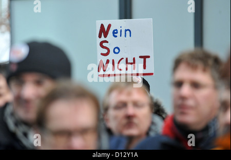 Employees of data networking and telecommunications equipment company Nokia Siemens Networks (NSN) attend a demonstration - Stock Photo