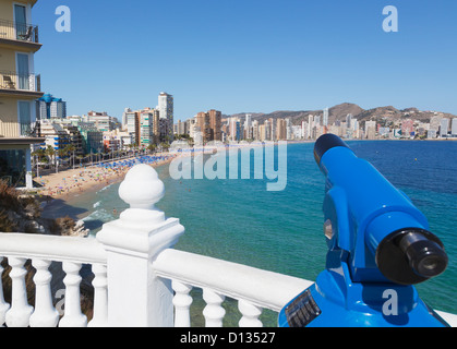 Telescope At A Railing With A Viewpoint To Leavante Beach; Benidorm Alicante Province Costa Blanca Spain - Stock Photo