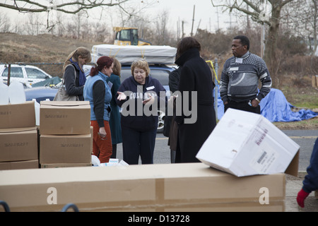 Hurricane Sandy Relief Center along the Jersey Shore in Monmouth County, New Jersey. volunteers with NGO relief - Stock Photo