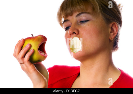 woman with angry red apple in hand - Stock Photo