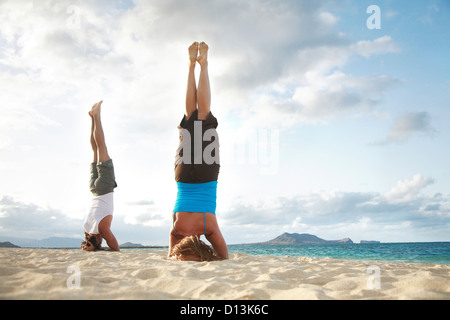 young man doing a headstand in gym stock photo 175575459