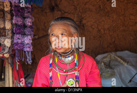 Elderly woman member of Karen Padong hilltribe village near Chiang Rai, northern Thailand - old lady with pierced - Stock Photo