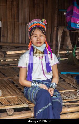 Woman longneck member of Karen Padong hilltribe village near Chiang Rai, northern Thailand, a Burmese refugee from - Stock Photo