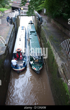 Narrow Boats Passing in a Lock on the Shropshire Union Canal at Chester - Stock Photo