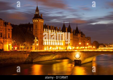 Twilight over the Conciergerie and Pont au Change along the River Seine, Paris France - Stock Photo
