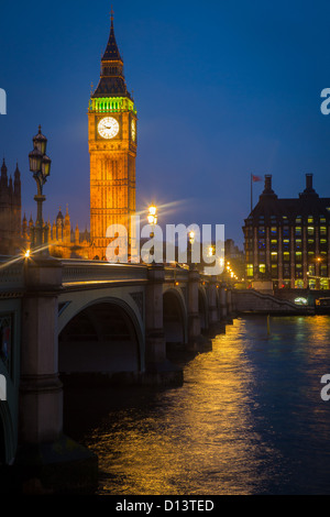 Westminster Bridge at night with Big Ben and the Houses of Parliament on the other side of the Thames - Stock Photo