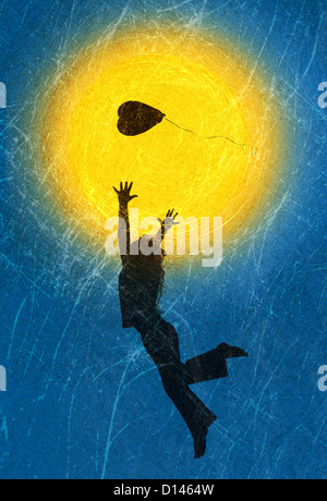 Silhouette of a young girl playing with a heart shape balloon against a textured sun and sky - Stock Photo