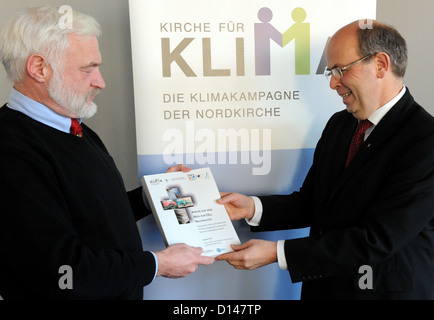 Nobel Prize laureate Olav Hohmeyer (L) from Flensburg University hands over the new climate protection concept of - Stock Photo