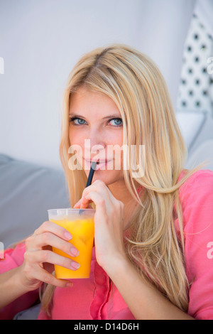 Woman drinking orange juice - Stock Photo