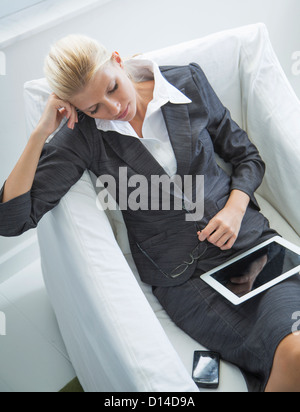 Businesswoman using tablet computer - Stock Photo