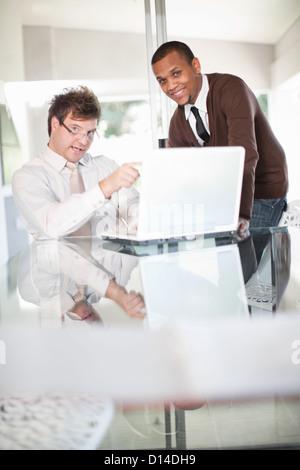 Businessmen talking in meeting - Stock Photo