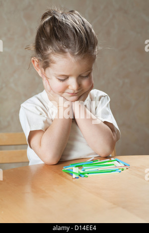 young girl with placing game - Stock Photo