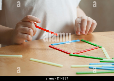 detail of young girl playing placing game - Stock Photo