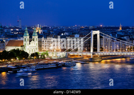 Cityscape of Budapest in Hungary at night with Inner City Parish Church and Elizabeth Bridge by the Danube river. - Stock Photo
