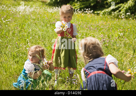Girls in traditional Bavarian clothes - Stock Photo