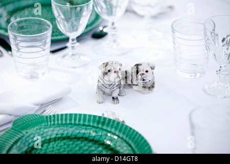 Dog figurines on table - Stock Photo