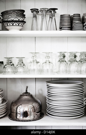 Shelves with glasses, plates and bowls