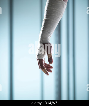 Close up of hand covered in bandages - Stock Photo