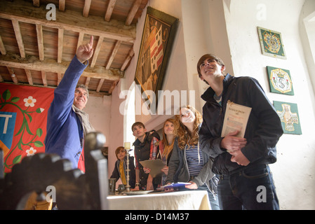 Students examining medieval castle - Stock Photo